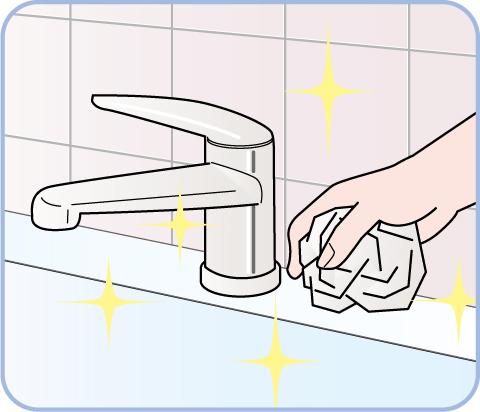 キッチンをラップで掃除しているイラスト